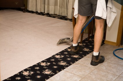 Clara Cleaning Services, LLC technician cleaning carpet via hot water extraction in Weston CT.