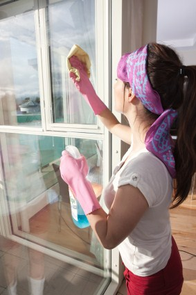 Window cleaning in Redding Ridge by Clara Cleaning Services, LLC - women cleaning window